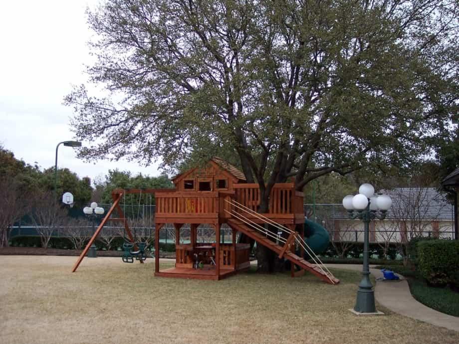Custom Fort Stockton swing set tree deck