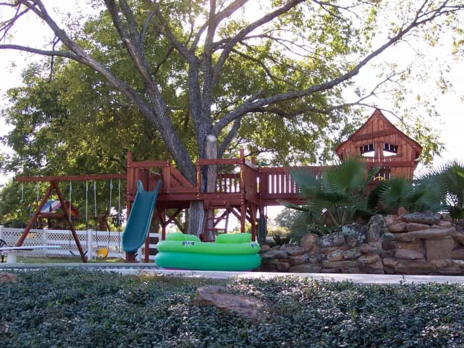 Fort Davis Jones swing set bridged to tree deck