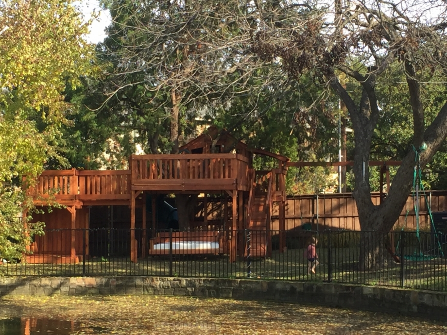 Fort Stockton swing set tree deck kids stage