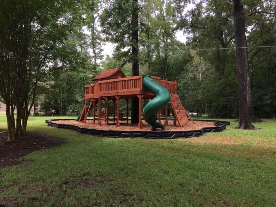 Fort Stockton swing set tree deck