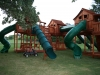 Custom Fort Stockton swing set twister slides