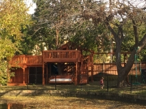 Fort Stockton Playset Bridged to a Child's Stage with Tree Deck