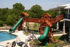 Fort Stocktons playset bridged to balcony of home