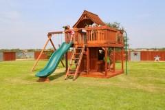 Maverick swing set with wrap around porch