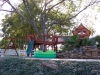 Fort Davis Jones swing set bridged to tree deck