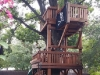 Multi-level tree decks bridged to Fort Stockton swing set