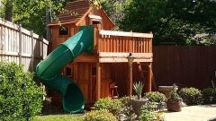 Maverick playset with twister slide